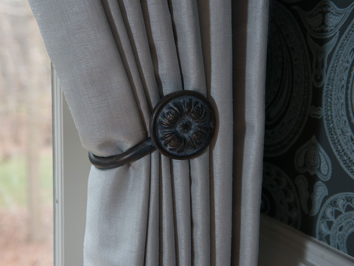 Gray curtain with metal holdback