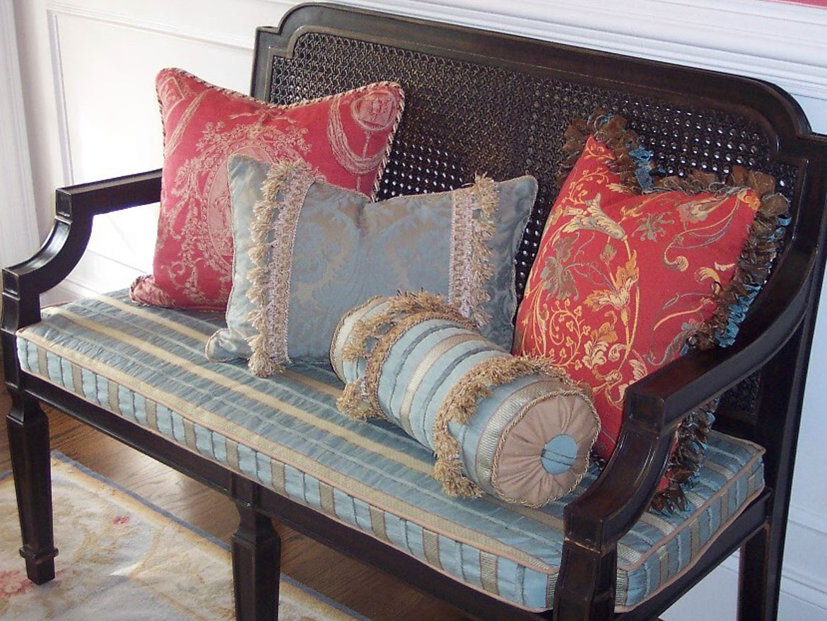 hallway bench with cushion and pillows