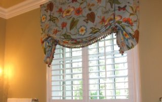 Plantation shutters paired with a valance